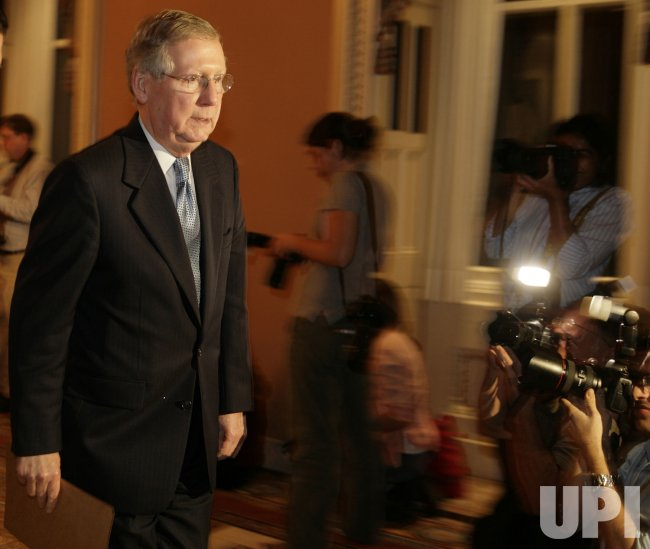 Senate Minority Leader Mitch McConnell walks on Capitol in Washington