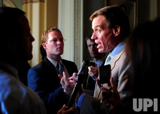 Sen. Mark Warner talks to reporters in Washington