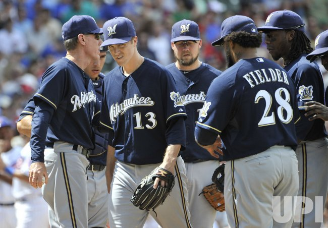 Brewers manager Roenicke takes out Greinke in Chicago