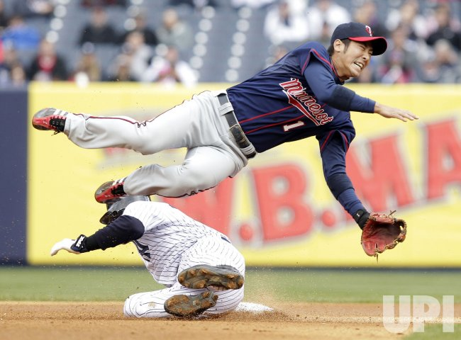 New York Yankees Nick Swisher injures Minnesota Twins Tsuyoshi Nishioka at Yankee Stadium in New York