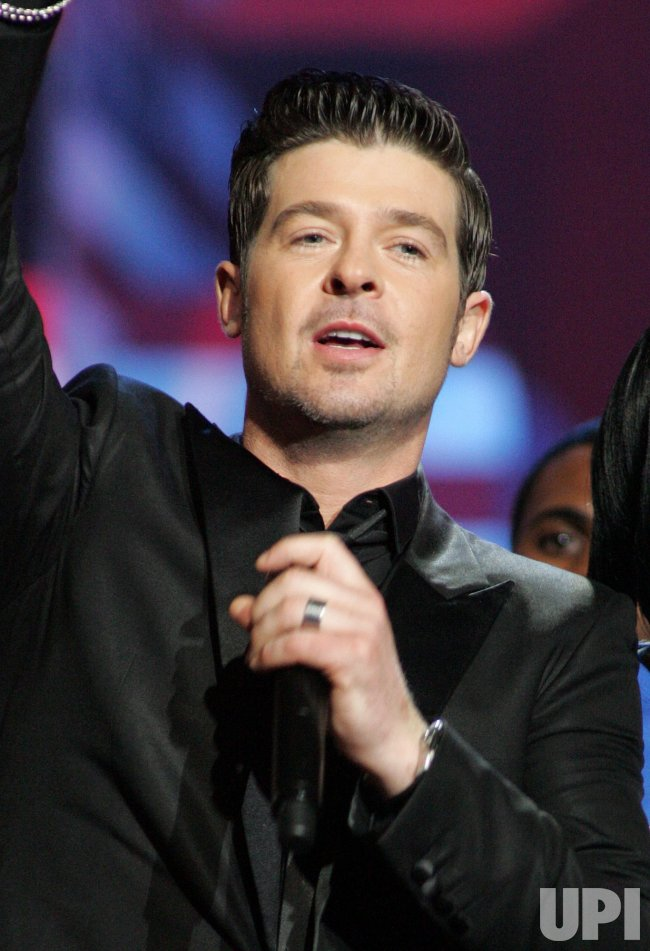 Robin Thicke performs at the SOS Saving Ourselves telethon