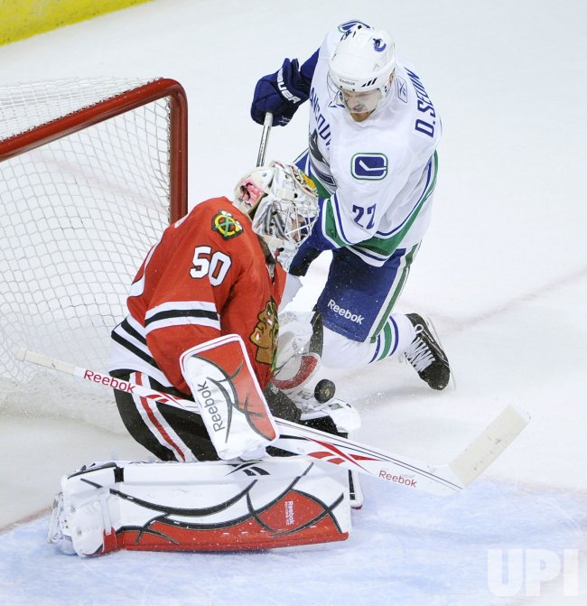 Blackhawks Crawford makes save on shot by Canucks Sedin in Chicago