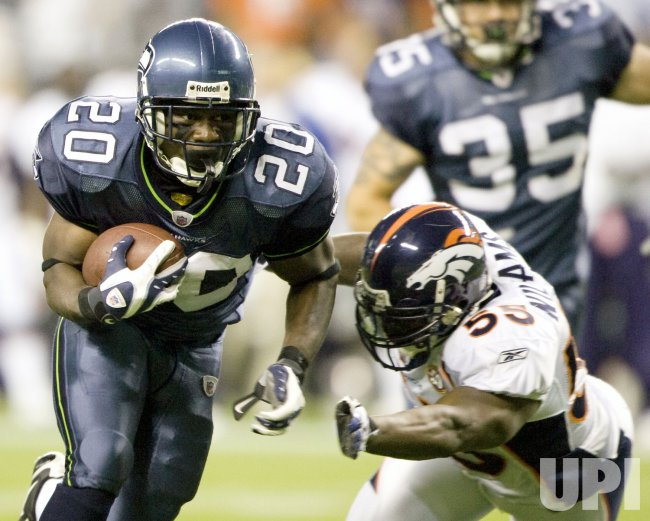 Seattle Seahawks running back Justin Forsett (L) picks up five yards before being tacked by Denver Broncos linebacker Andra Davis in the third quarter at Qwest Field in Seattle on August 22, 2009.