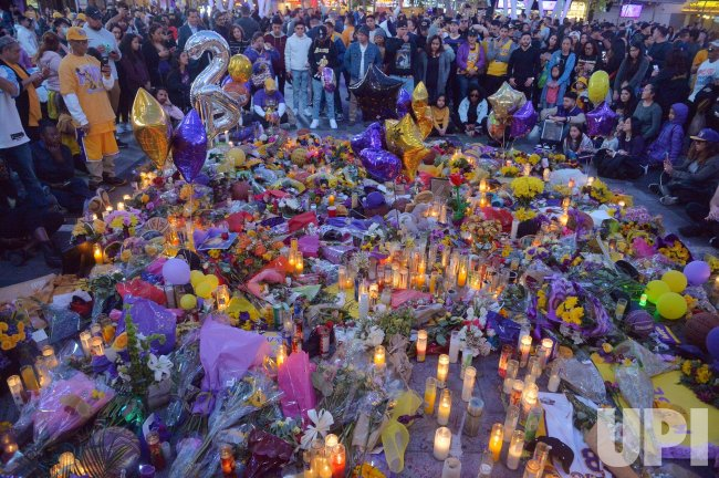 Fans gather to mourn the death of Kobe Bryant at Staples Center in Los Angeles