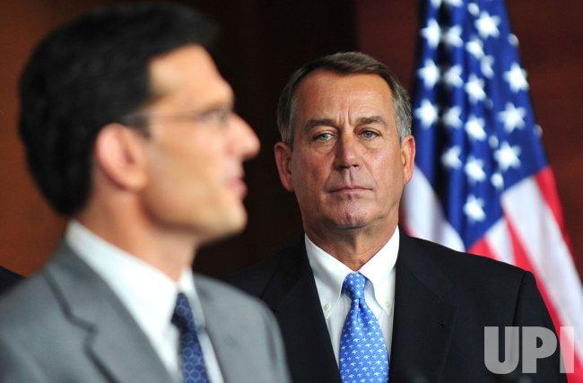 Speaker of the House John Boehner watches as House Majority Leader Eric Cantor speaks on the debt ceiling vote in Washington