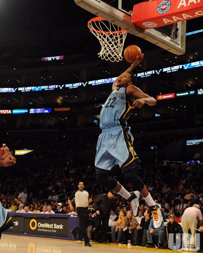 Rudy Gay slam dunks the ball in Los Angeles