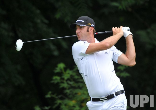 Dustin Johnson watches his drive at the US Open in Maryland