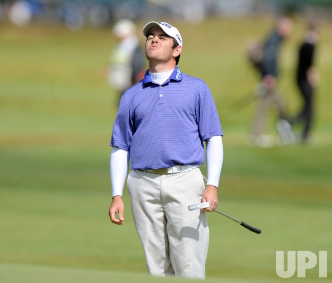 Oosthuizen reacts after a putt on the second day of the Open championship.