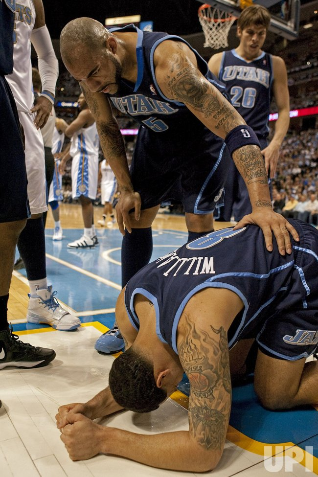 Jazz Boozer and Korver Check on Injured Teammate Williams in Game Two in Denver