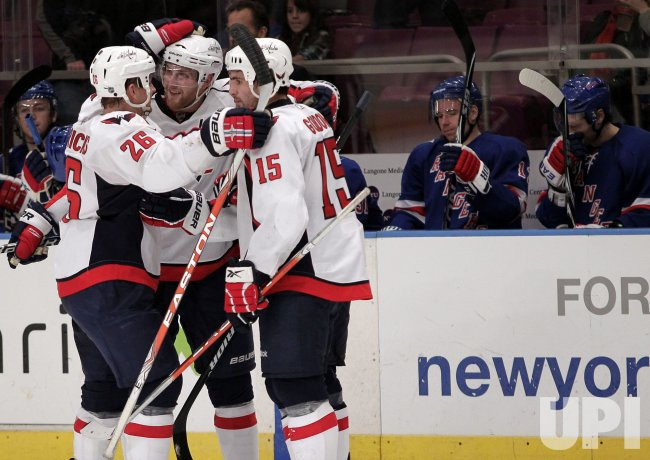 Washington Capitals Boyd Gordon (15) Karl Alzner, and Matt Hendricks (26) react after a goal at Madison Square Garden in New York