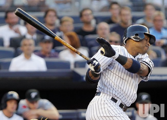 New York Yankees Robinson Cano reacts after a swing at Yankee Stadium in New York