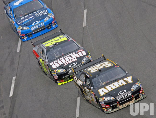 Ryan Newman leads Jeff Gordon, and Martin Truex Jr at the Martinsville Speedway in Martinsville, Virginia