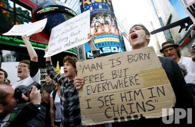 Occupy Wall Street demonstrators rally in Time Square in New York