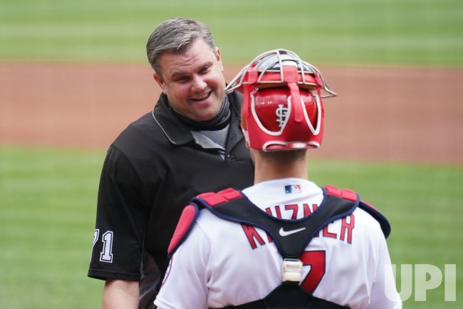 Home Plate Umpire Jordan Baker Talks To St. Louis Cardinals Catcher Andrew Knizner