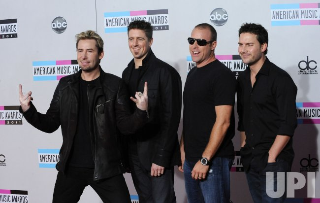 Musicians Chad Kroeger, Daniel Adair, Mike Kroeger and Ryan Peake of the band Nickelback arrive at the 39th American Music Awards in Los Angeles