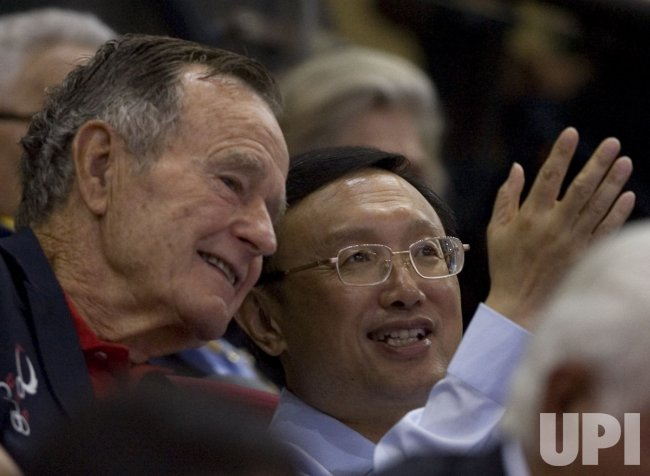 Former President Bush Sr. attends Olympic basketball game in Beijing