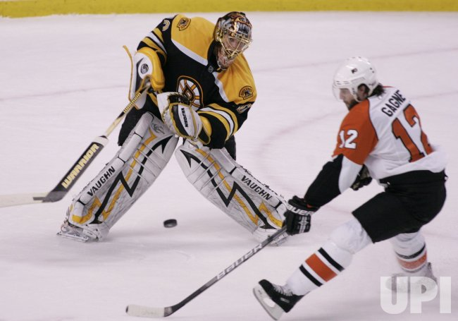 Bruins Rask save against Flyers Gagne in Game 7 of the NHL Eastern Conference Semi-Final in Boston, MA.