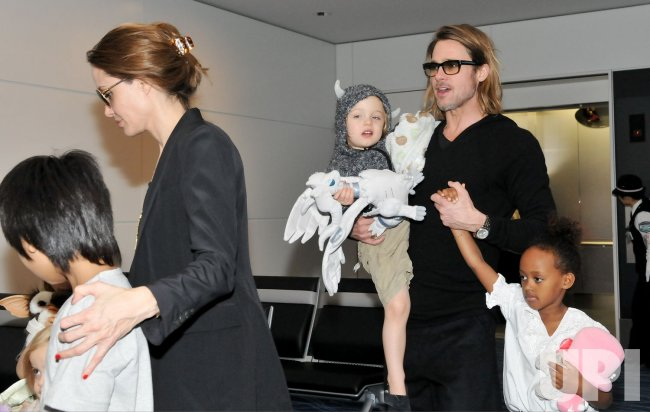 "Pitt and Jolie Leave Japan after ""Moneyball"" Premiere"