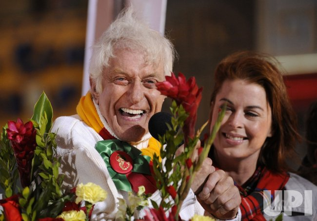Actor Dick Van Dyke rides in the Hollywood Christmas Parade in the Hollywood section of Los Angeles