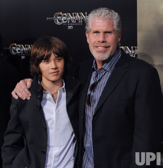 Leo Howard and Ron Perlman attend the premiere of