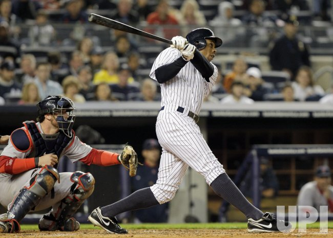 New York Yankees Curtis Granderson hits a 2-run homer at Yankee Stadium in New York
