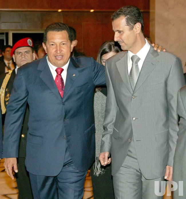 HUGO CHAVEZ PLEDGES TO STAND BY BASHAR AL-ASSAD