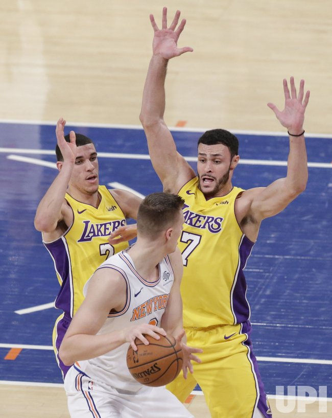 Lakers Lonzo Ball and Larry Nance Jr. surround Porzingis