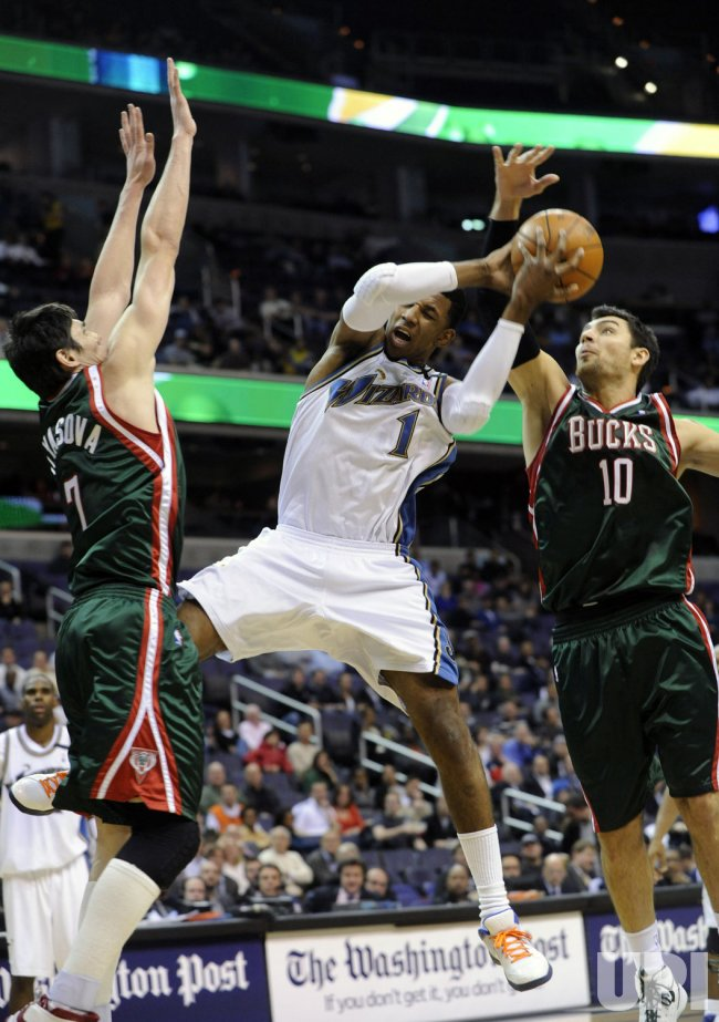 Bucks Delfino fouls Wizards Young in Washington