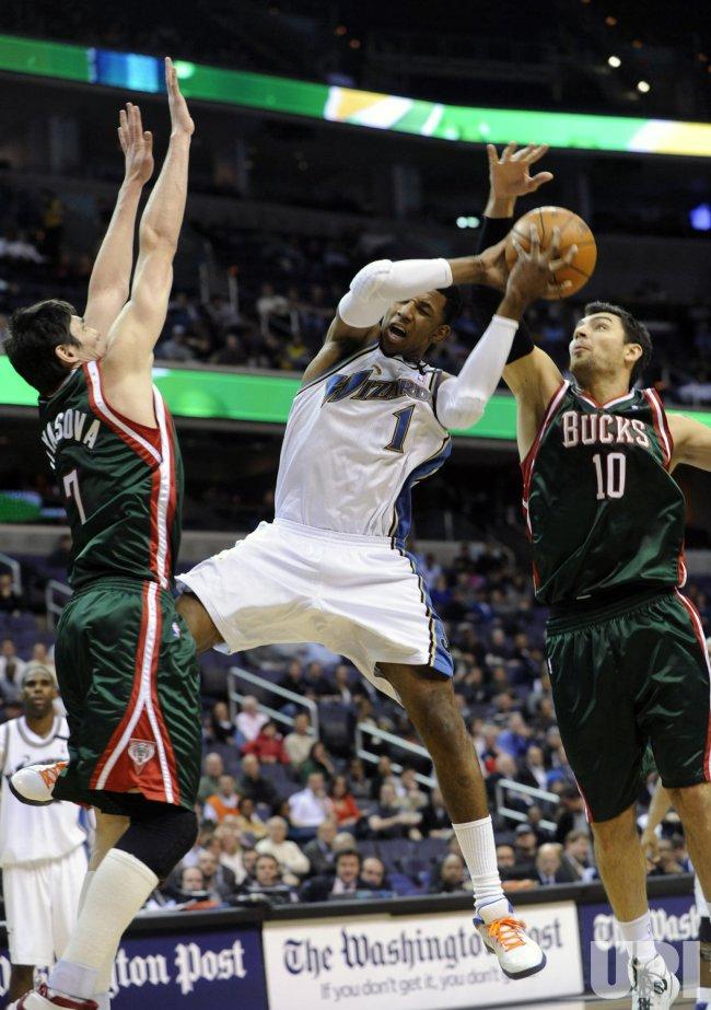 Bucks Delfino fouls Wizards Young in Washington