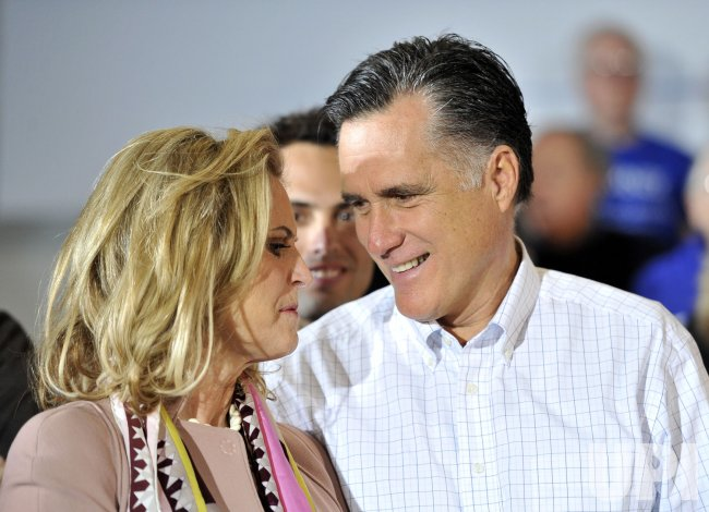 Romney and wife stand on stage at rally in Davenport, Iowa