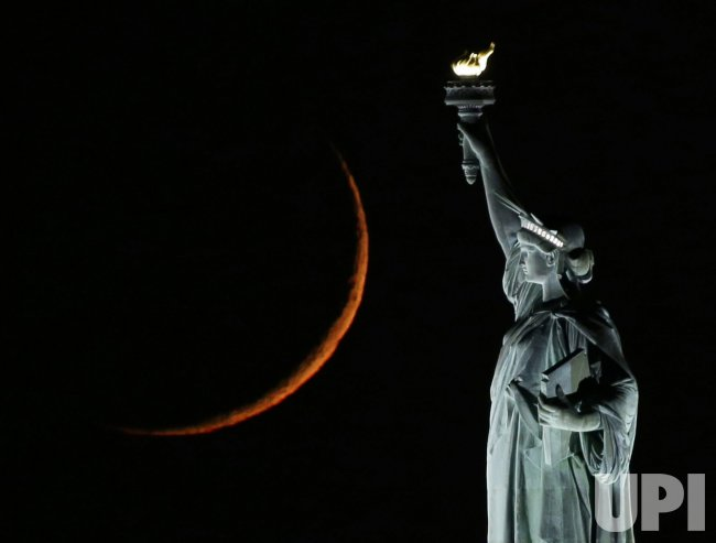 Waxing Crescent Moon with the Statue Of Liberty in New York