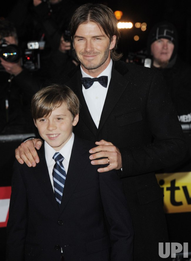 "David and Brooklyn Beckham attend ""A Night Of Heroes: The Sun Military Awards"" in London"