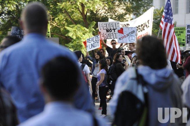 Occupy LA protesters participate in a march in Los Angeles