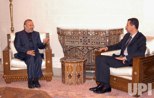Iran's foreign minister Manouchehr Mottaki meets Syrian President Bashar Assad in Syria
