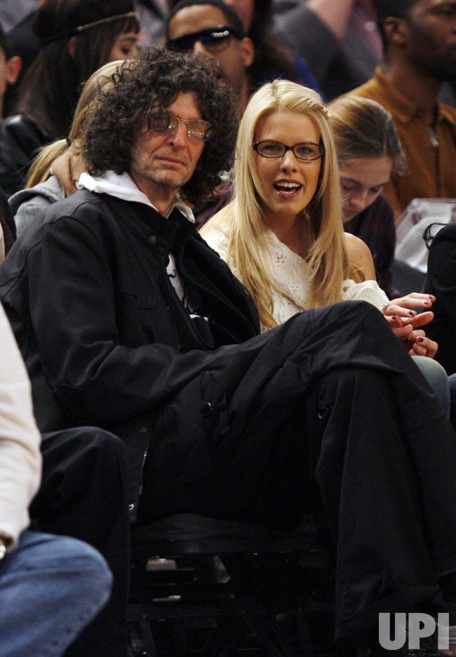 Howard Stern and Beth Ostrosky watch the Los Angeles Clippers play the New York Knicks in the first half at Madison Square Garden in New York