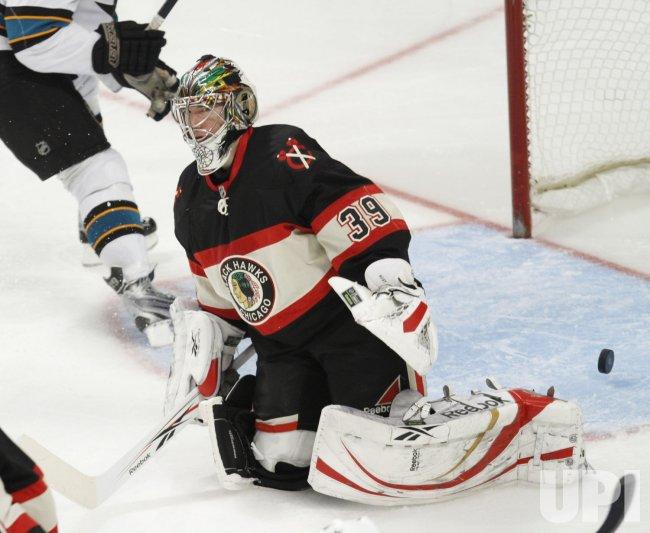 Blackhawks' Huet reacts to Sharks goal in Chicago