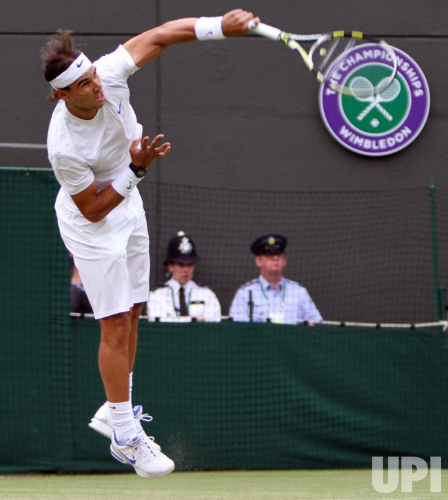 Rafael Nadal serves at Wimbledon.