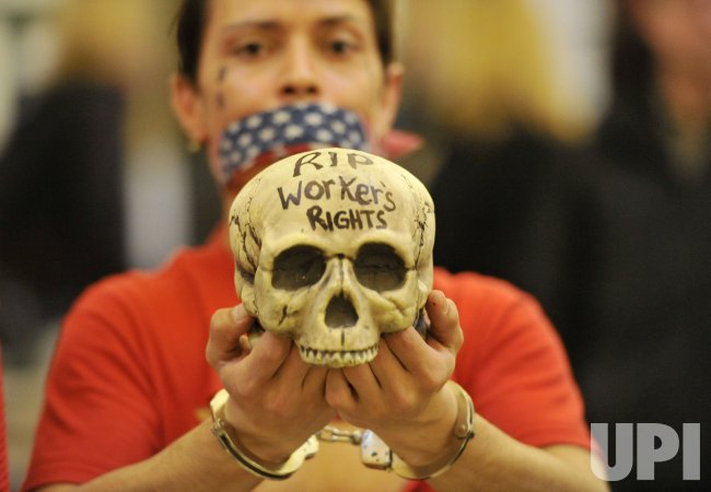 Protesters walks with skull at capitol in Madison, Wisconsin
