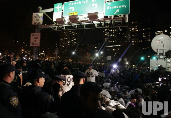 Occupy Wall Street Protesters Rally in Foley Square and around the Brooklyn Bridge in New York