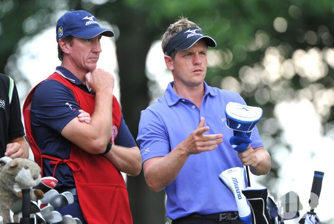 Luke Donald of England and his caddie John McLaren talk at the US Open in Maryland