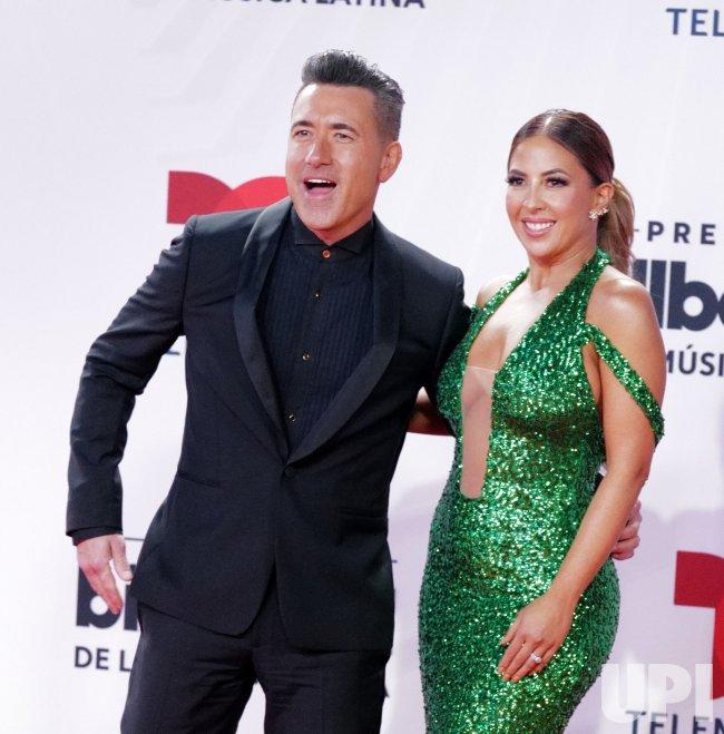 Jorge Bernal and Stephanie Himonidis walk the red carpet at the 2020 Latin Billboard Awards in Sunrise, Florida