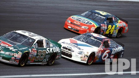 Mark Martin(6) passes Jeff Gordon(24) in turn four as he encounters Kenny Schrader
