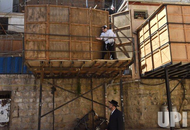 An Ultra-Orthodox Jew Builds A Sukkah In Jerusalem