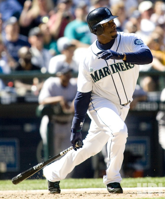 Seattle Mariners' Ken Griffey Jr watches his single to center field against the New York Yankees in the seventh inning at SAFECO Field in Seattle.