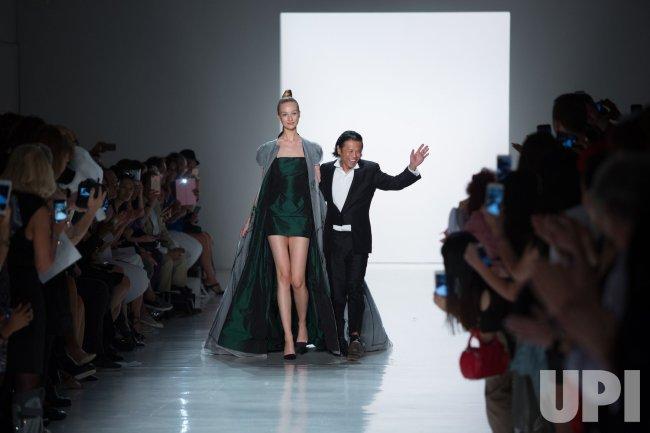 Designer Zang Toi walks on the runway at the Zang Toi fashion show