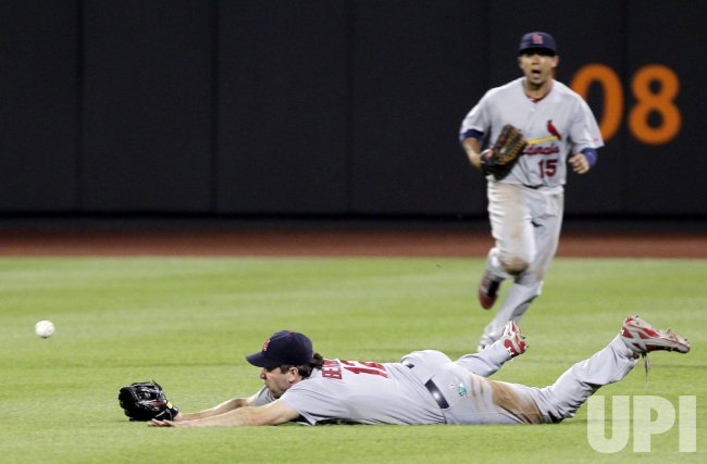 St. Louis Cardinals Lance Berkman dives for a ball at Citi Field in New York