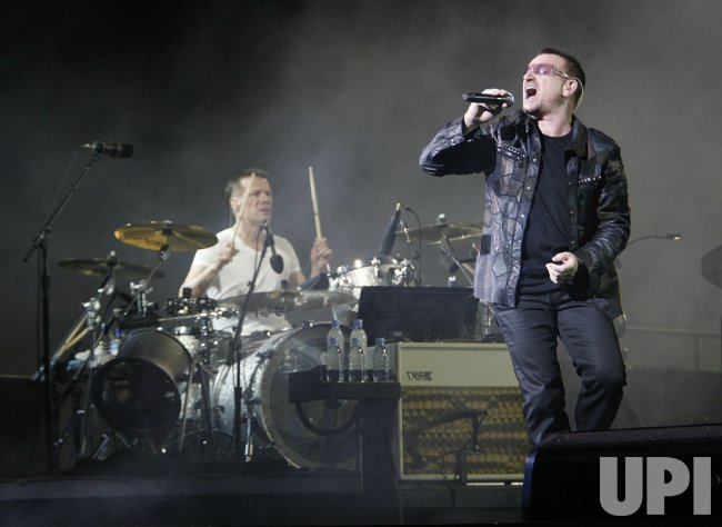 Bono and Larry Mullen Jr  of U2 perform during the first