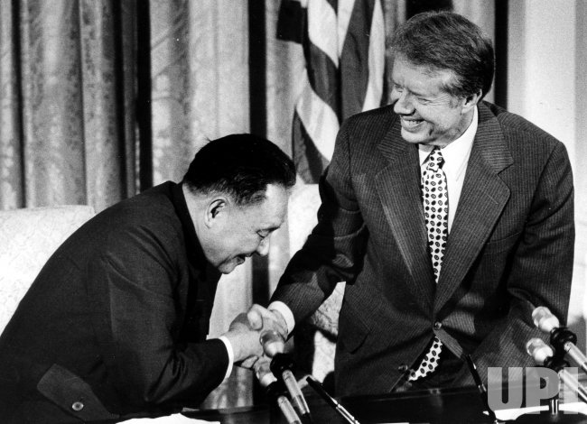 Jimmy Carter and Deng Xiaoping shake hands following a ceremony at the White House.