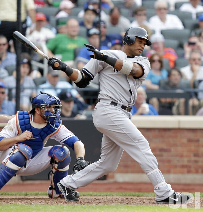 New York Yankees Robinson Cano drives in 2 runs with a triple at Citi Field in New York