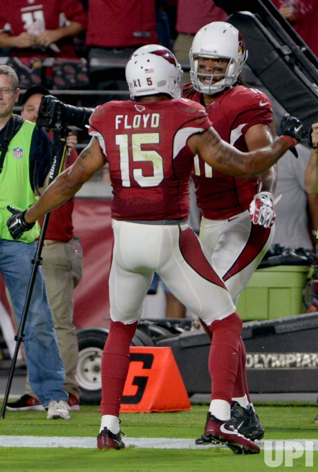 Cardinals' Fitzgerald is congratulated for touchdown